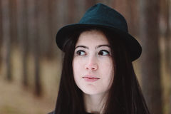 Face of the cute girl against the forest. Stock Photos