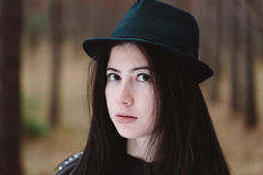 Face of the cute girl against the forest. Royalty Free Stock Image
