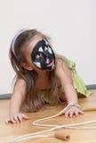 Face da menina igualmente pintada do cão Foto de Stock