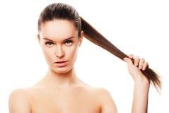 A face da mulher bonita com pele limpa no branco Foto de Stock