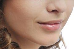 Face da mulher - detalhe da boca e dos bordos Imagens de Stock