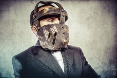 Face, dangerous business man with iron mask and expressions Royalty Free Stock Photos
