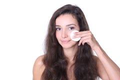 Face de limpeza com loção Imagem de Stock