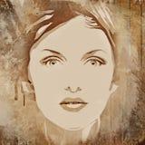 face de uma mulher bonita em um fundo do grunge Fotos de Stock Royalty Free
