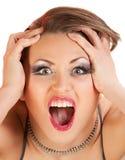 Face de uma mulher de grito nova. Fotos de Stock