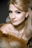 Face de uma mulher loura nova bonita imagem de stock royalty free