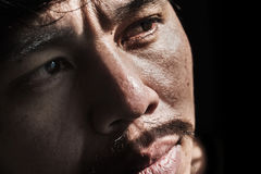 Face of depressed and hopeless man. On black Royalty Free Stock Photography