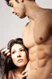 The Face Of Desire. A men cradles the face of a women against his abdomen, expression of desire royalty free stock image