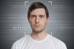 Face detection and recognition of man. Computer vision concept. Binary code in background.  royalty free stock photo
