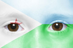 Face with djibouti flag. Human`s face with djibouti flag stock photography