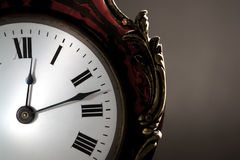 Face do relógio antiga com mãos Imagens de Stock