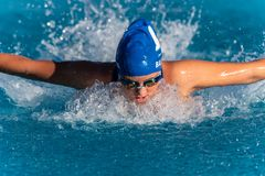 Face down technique during swim race. stock photo