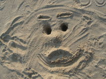 Face drawn in sand Royalty Free Stock Photos