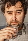 Face of drunkard. The face of drunkard without fixed place of residence, a cardboard dweller Stock Photo