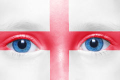 Face with english flag. Human`s face with english flag stock images