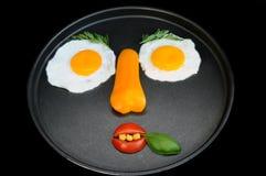 Face engraçada dos ovos fritados Fotografia de Stock