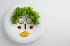 Face engraçada feita com vegetais Fotografia de Stock Royalty Free
