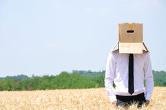 Face escondendo do homem de negócio Imagem de Stock Royalty Free