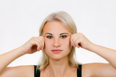 Face exercise jawline massage. Funny female face with hands pulling the skin stock images