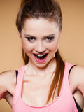 Face expression of funny teen girl on brown Royalty Free Stock Photos