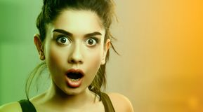 Face expression of shocked surprised young woman royalty free stock photos