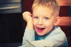 Happy kid boy looking straight to camera stock photos