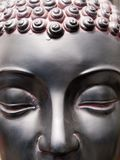 The face of a bronze buddha figurine stock photo