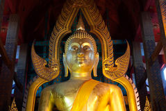 Face of famous large sitting Buddha in Thai Temple. Royalty Free Stock Images