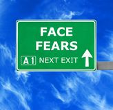 FACE FEARS road sign against clear blue sky royalty free stock images