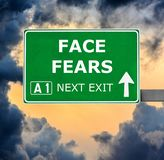 FACE FEARS road sign against clear blue sky stock photography