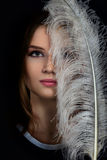 Face with feather Stock Photography