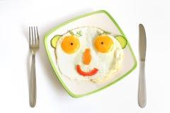 Face feliz com ovos da fritada Foto de Stock