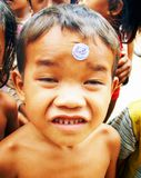 Face First. Young Khmer kid trying to push in front of camera. Cambodia Royalty Free Stock Image