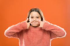 Face fitness concept. Funny grimace. Kid demonstrate massage face skin. Face building exercises. Forever young. Girl. Cute kid elastic skin show exercises for stock photography