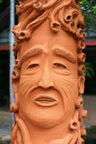 Face flowerpot. The image of the flowerpot in human face style stock photo