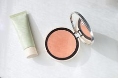 Face foundation green tube Pressed powder Blush Make up Beauty c. Oncept Decorative Cosmetics White background Isolated Copy space Top view Organic cosmetics royalty free stock image