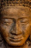 Face front of stone Buddha Stock Photography