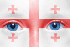 Face with georgian flag. Human`s face with georgian flag royalty free stock image