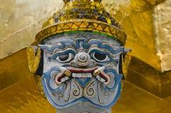 Face of the giant. Temple of the Emerald Buddha (Wat Phra Kaew), Bangkok, Thailand Royalty Free Stock Photo
