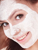 Face of girl with clay mask. Royalty Free Stock Photos