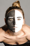 Face of girl with dual greasepaint Royalty Free Stock Image