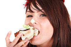 Face of girl eating cake. Stock Photos