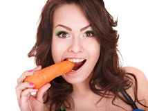 Face of girl eating carrot. Stock Image