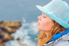 The face of girl on the edge of the earth, Finister, Bretagne Stock Photo