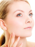 Face girl with healthy pure complexion. Skin care. Royalty Free Stock Photos