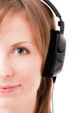 Face of girl listening music. Front view Royalty Free Stock Images