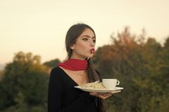 Young beautiful caucasian woman enjoys while eating delicious pasta. Face girl for magazine cover. Girl face portrait in. Face girl for magazine cover. Girl face Stock Photo