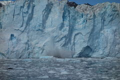The face of a glacier in the process of calving. Stock Photo
