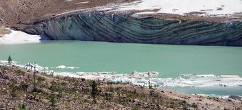 The face of a glacier showing striations Stock Photography