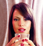 Face and glass of whisky Stock Photography